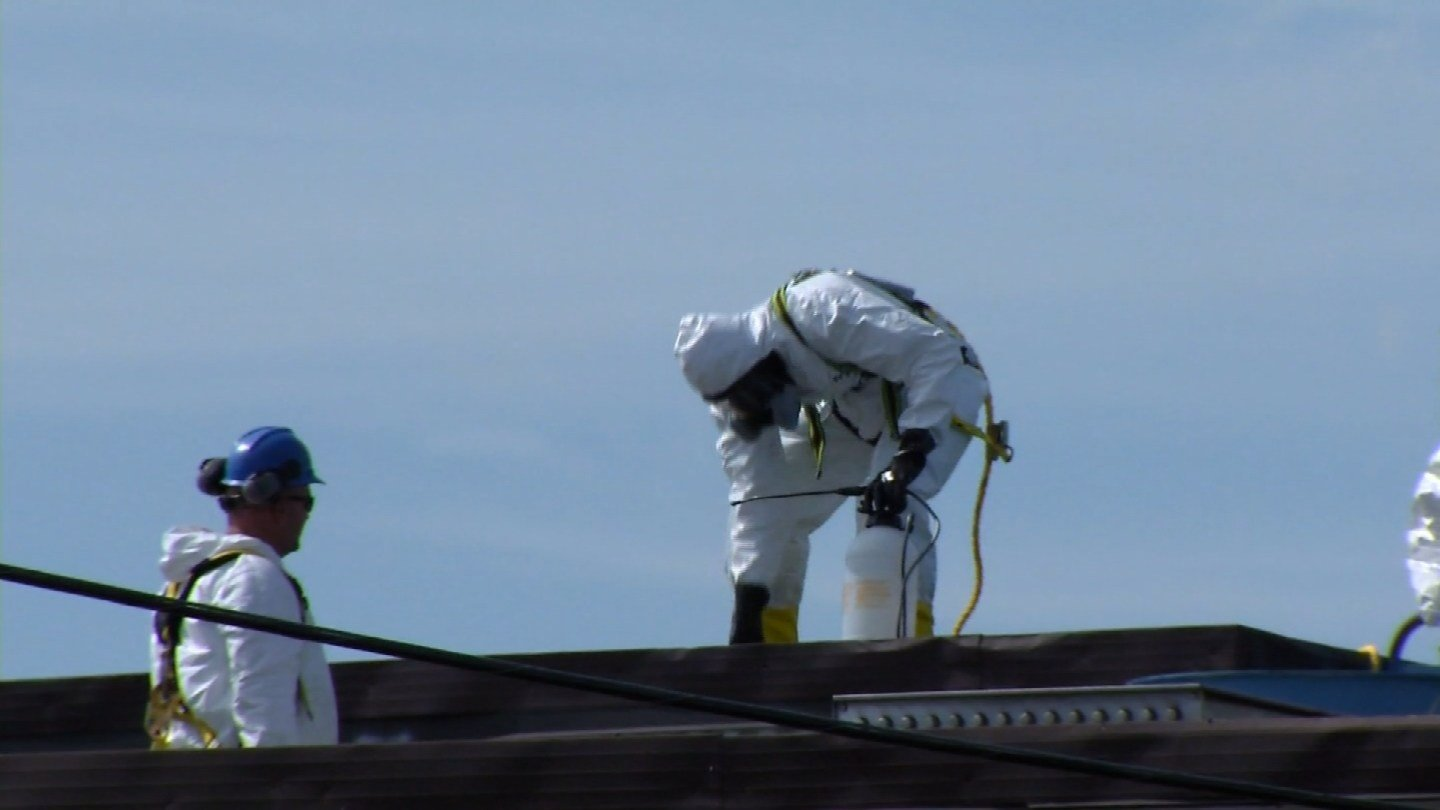 Crews check the roof of Light Metals Coloring in Southington on Thursday. (WFSB photo)