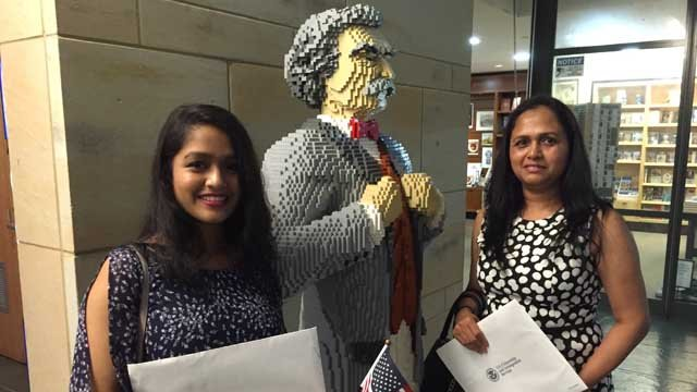 Rutvi and Minaxi Patel from India took the Oath of Allegiance at the Mark Twain House on Friday. (WFSB photo)