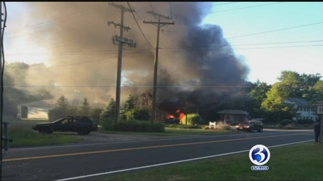 Police say a driver accidentally hit a gas pump which started a huge fire (WFSB)
