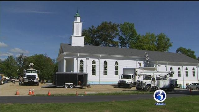 """A new church steeple was dangling in the wind on Tuesday and waiting for its big moment at the top of the """"new"""" First Congregational Church of Pomfret. (WFSB)"""