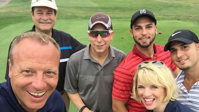 Channel 3 anchors Scot Haney and Irene O'Connor plays in the 19th annual Kids Camp Golf Tournament. (WFSB)