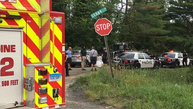 Emergency crews were called to a reservoir in Middletown after a car went into the water (WFSB)