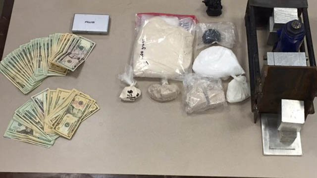 The third suspect had 1.5 kilograms of uncut heroin, 100 grams of cocaine, 80 grams of black tar heroin and $1,600 in cash.(Hartford police photo)