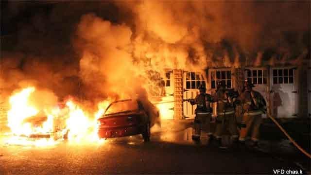 Crews battled a fire that destroyed three cars in Vernon. (Chas Konarski)
