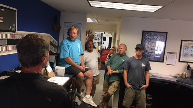 Boats Inc. Marina employees go over storm preparations ahead Hermine. (WFSB)