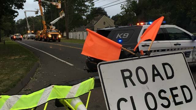 Cromwell Place and Willard Avenue Extension were closed in Old Saybrook due to snapped utility poles. (WFSB photo)