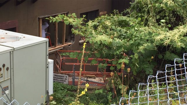 Crews were working on structure after car crashed into building. (WFSB)