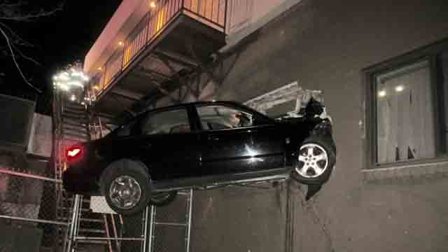 car crashes into side of plainville building after traffic stop