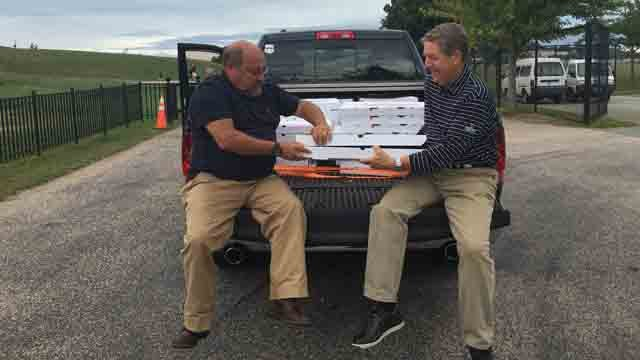 Reid Burdick and Glenn Hamler treated crew members to pizza on Monday. (Submitted)