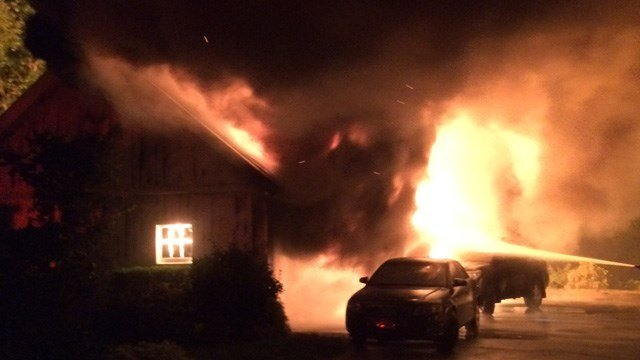 """Firefighters called this garage fire on Point Road """"stubborn."""" (Norwalk Fire Dept. photo)"""