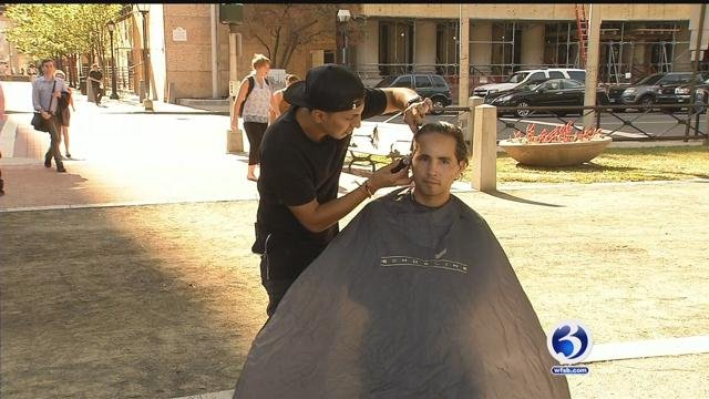 Joffrey Jara gives out free haircuts on his off-days in New Haven. (WFSB)