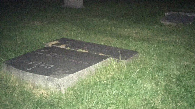 Middletown PD say 15 to 20 gravestones were knocked over by a vandal Saturday night. (WFSB)