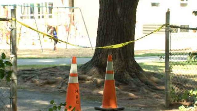 Caution tape is set up in front of a trail near a West Hartford school (WFSB)