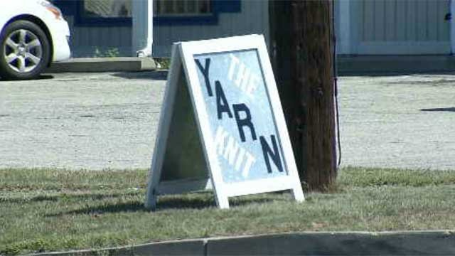 Illegal signs outside of businesses are being taken down (WFSB)