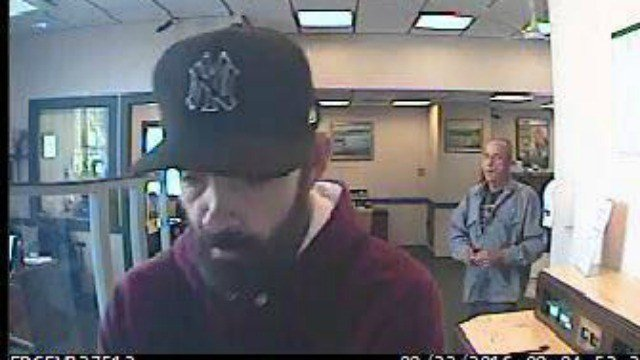 State police say they are looking for this man in connection with a bank robbery in Canterbury. (State PD)