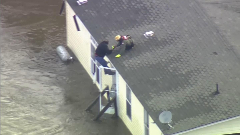 The U.S. Coast Guard rescues a man in North Carolina. (CBS photo)