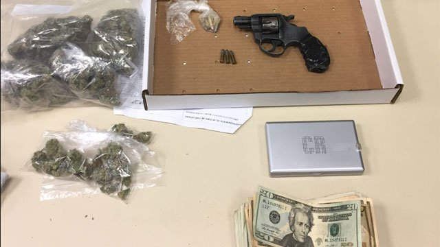 Officers seized a firearm, money and marijuana during a motor vehicle stop in Hartford on Friday night. (Hartford Police Department)