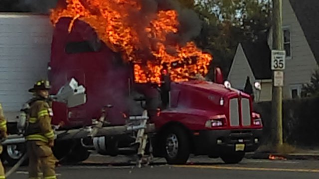 Tractor-trailer catches on fire in Waterbury after crash on Wednesday. (Don)