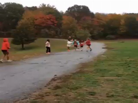 Teammates gather together to help out another at a cross country meet (Submitted)