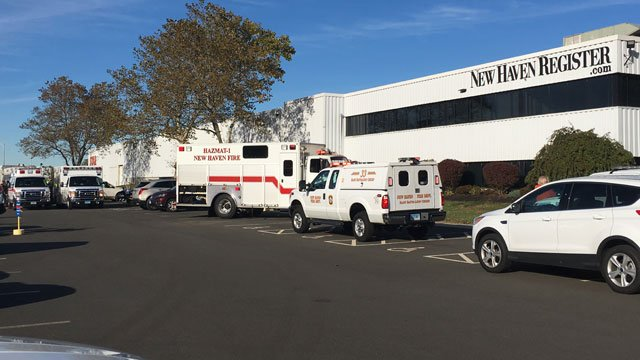 Police, firefighters and ambulances were at the New Haven Register following discovery of suspicious powder. (WFSB)