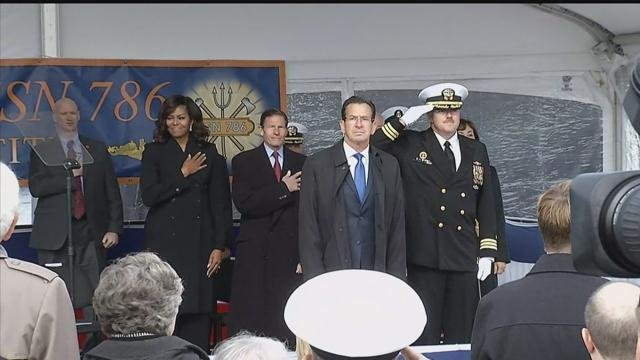 The first lady, governor and other officials stand during commissioning ceremony. (WFSB)