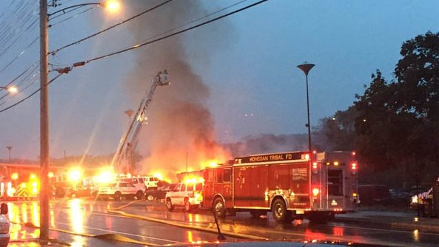 Crews battled a fire at a Norwich auto service center on Sunday (WFSB)