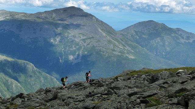 A pair of hikers traverse the trail New Hampshire's Presidential Range Wednesday, July 27, 2016, on Mount Washington, N.H. (AP Photo/Jim Cole)