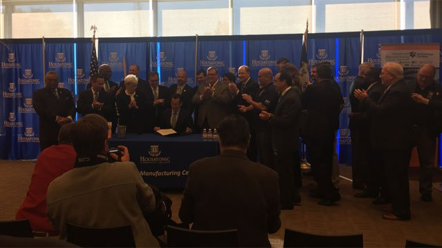 Gov. Dannel P. Malloy signs Sikorsky bill. (WFSB)