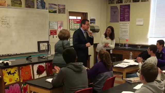 Gov. Dannel Malloy tells Lauren Danner she is the CT Teacher of Year. (WFSB)
