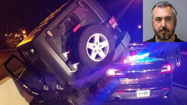 Michael Gauvin was charged with DUI after his Jeep landed on a state police cruiser in Wethersfield. (State police photos)