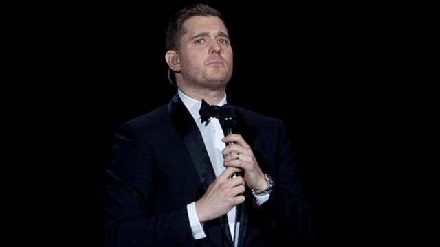 Canadian singer Michael Buble performs during a concert. (AP photo)