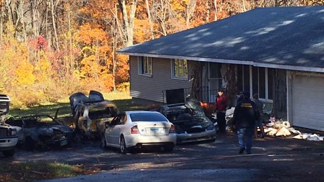 Police are investigating after several cars were set on fire in Ellington (WFSB)