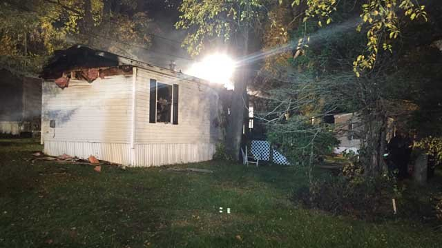 A mobile home in East Windsor was heavily damaged in a fire Sunday night (WFSB)