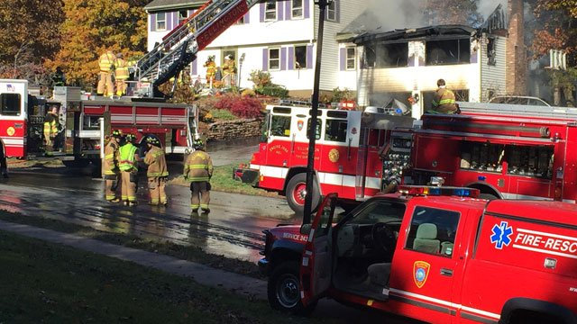 Firefighters are investigating a fire on Wells Road in Ellington.  (WFSB)