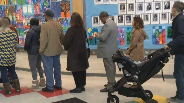 People waiting in long lines in New Haven to vote on Election Day. (WFSB)