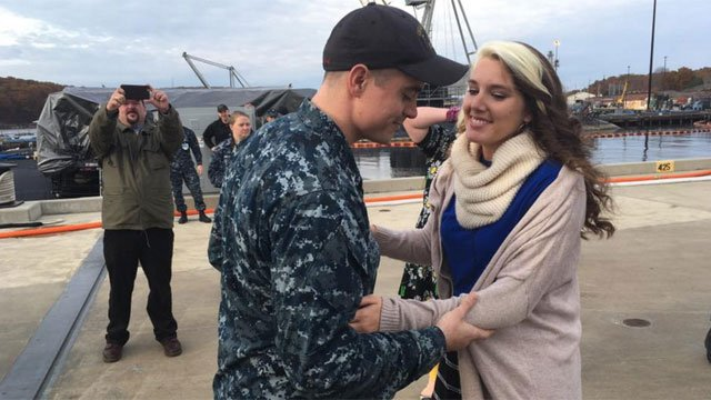 Petty Officer Benjamin Gaston proposes to his girlfriend of five years, Sarah Eastwood. (WFSB)