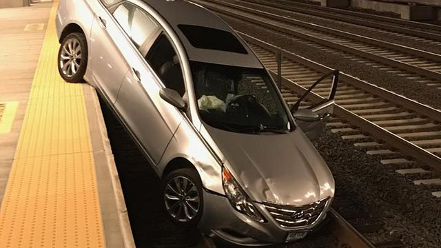 A driver suffered a medical emergency and crashed onto the track tracks at the West Haven Metro-North station, police said. (West Haven police photo)