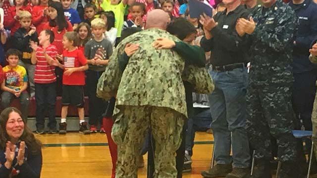 SCPO Leonard Viggiani, U.S. Navy, surprises his family at Colchester Elementary School. (WFSB photo)