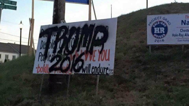 A sign intended to spread love was vandalized Thursday. (WFSB)