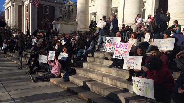 Hundreds attended a rally in New Haven on Sunday afternoon, protesting President-elect Donald Trump. (WFSB)