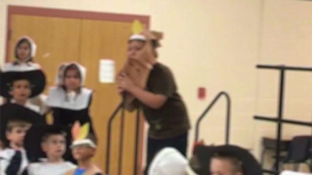 Video shows teacher take mic from autistic boy. (CNN)