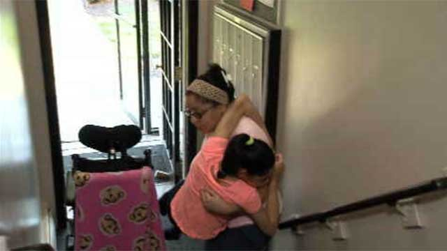 A Hartford mother is asking for a ramp at her apartment building to make it easier to transport her daughter. (WFSB)