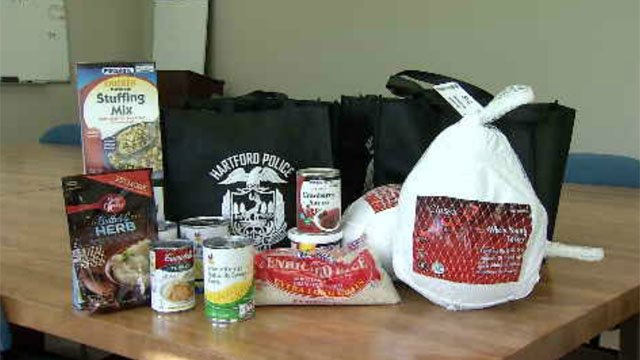 Hartford police deliver Thanksgiving meals on Tuesday (WFSB)