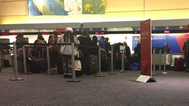 Travelers wait in line early Wednesday at Bradley International Airport. (WFSB photo)