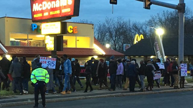 Workers rallied for $15 per hour at a McDonald's restaurant in Hartford Tuesday morning. (WFSB photo)