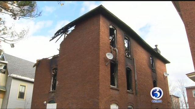 Residents of Hartford urged the city to tear down a three family home on Babcock Street destroyed by arson last September.  (WFSB)