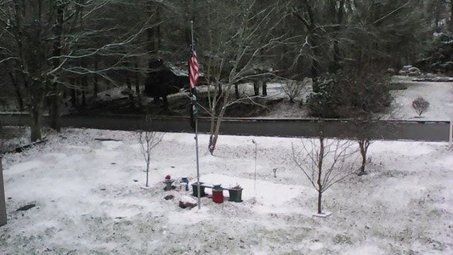 Snow coated the grassy surfaces in North Windham Monday. (iWitness photo)