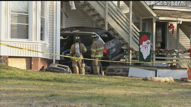 An SUV slammed into a home on Wall and Broad Streets in Meriden Tuesday morning. (WFSB photo)