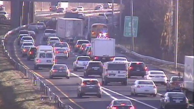 A crash involving a box truck and a school bus was reported on the eastbound side of Interstate 84 east in Farmington on Tuesday.  (CT DOT)