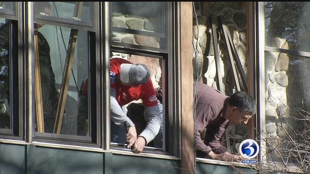 Volunteers worked to install new windows at the Channel 3 Kids Camp on Tuesday (WFSB)
